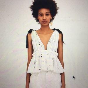 Zara white top with black bows